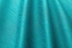Paño de lujo del fondo de la turquesa o dobleces ondulados del satén de seda de la textura del grunge Foto de archivo libre de regalías