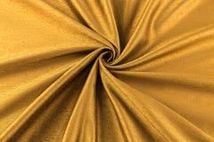 Paño de lujo del fondo de oro o dobleces ondulados del satén de seda de la textura del grunge Fotografía de archivo