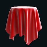 Paño de seda rojo en el objeto o la tabla redondo Fotografía de archivo