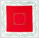 Paño rojo de la Navidad bordado con acebo Foto de archivo libre de regalías