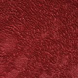 Paño rojo oscuro de la toalla del color Fotos de archivo