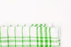 Paño verde, una toalla de cocina con un modelo a cuadros, en una pizca Imagenes de archivo