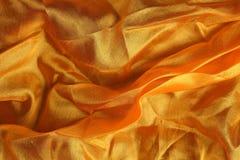 Pañuelo de seda de oro brillante Fotos de archivo libres de regalías