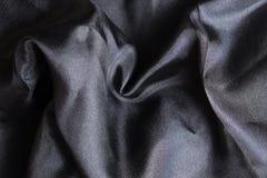 Pañuelo de seda negro brillante Imágenes de archivo libres de regalías