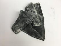 Pañuelo negro sucio imagenes de archivo