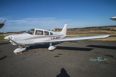 PA-28-151 Cherokee LN-BGT. PA-28-151 Cherokee which is a type of aircraft: fixed wing single engine are parked at Rakkestad airport.  Image is shot at Rakkestad Royalty Free Stock Photography