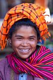 Pa-O tribe woman, Myanmar. SANGHAR, MYANMAR - JANUARY 15: An unidentified smiling Pa-O tribe woman posing for the photo on the local Htamanu Festival on January royalty free stock photography