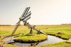 Paaltjasker windmill in Kalenberg in Friesland, Netherlands. Paaltjasker windmill in Kalenberg meadow  in Friesland, in the Netherlands Stock Photos