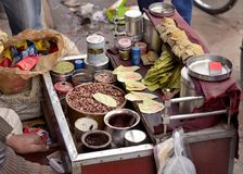 Paan. DELHI, INDIA. FEB 8, 2014. A man prepares 'Paan'. Paan is a stimulant psychoactive preparation of betel leaf combined with areca nut and cured tobacco Stock Photo