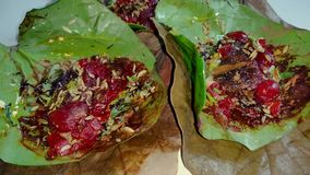Paan, also spelled pan, also called betel quid, an Indian after-dinner treat that consists of a betel leaf.  stock video