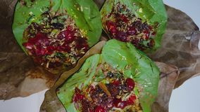 Paan, also spelled pan, also called betel quid, an Indian after-dinner treat that consists of a betel leaf. Paan,also spelled pan, also called betel quid, an stock video footage