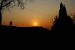 Paar bij de zonsondergang Royalty-vrije Stock Foto