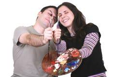 Paar dat pret heeft terwijl het schilderen Stock Foto