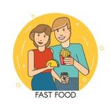 Paar dat snel voedsel eet Stock Foto's