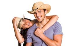 Paar in de aanpassing van strohoeden Royalty-vrije Stock Fotografie