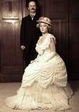 Paar in de 19de eeuwkledingstuk met vrouw in dominante rol Royalty-vrije Stock Afbeelding