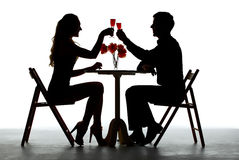 Paar die Diner met Wijnglas hebben op Lijst Stock Foto