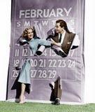 Paar die door schrikkeljaarkalender barsten (Alle afgeschilderde personen leven niet langer en geen landgoed bestaat Leveranciers royalty-vrije stock afbeelding