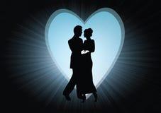Paar in een hart met stralen Stock Afbeelding