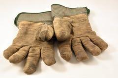 Paar goed gebruikte handschoenen Stock Foto