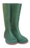 Paar groene rubberlaarzen Stock Foto's