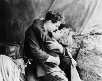 Paar in hartstochtelijke greep (Alle afgeschilderde personen leven niet langer en geen landgoed bestaat Leveranciersgaranties die Royalty-vrije Stock Fotografie