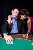 Paar in het casino Stock Afbeeldingen