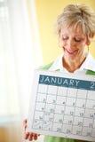 Paar: Het houden van een Januari-Kalender Stock Fotografie