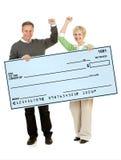 Paar: Het steunen van een Blanco cheque Royalty-vrije Stock Foto