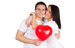 Paar met een rood hart Royalty-vrije Stock Afbeeldingen