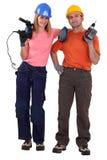 Paar met machtsboren die wordt bevonden Stock Fotografie