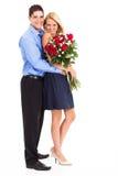 Paar met rozen Stock Afbeeldingen