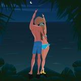 Paar op het strand die de sterren en de komeet bekijken Stock Afbeeldingen