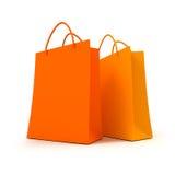 Paar oranje het winkelen zakken Stock Foto's