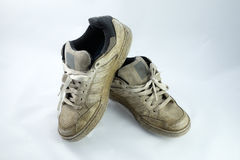 Paar oude vuile gymschoenen Stock Afbeelding