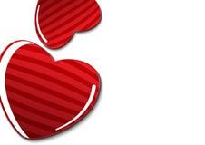 Paar rode harten op witte achtergrondexemplaarruimte op recht Stock Foto's