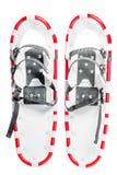 Paar sneeuwschoenen voor de wintergangen op de witte achtergrond Royalty-vrije Stock Foto