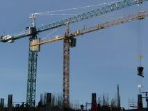 Paar van bouwkranen Stock Foto