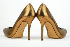 Paar van gouden gekleurde Hoge Hiel Stock Afbeeldingen