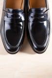 Paar van Modieus Duur Modern Leer Zwarte Penny Loafers Sho Stock Foto