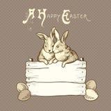 Paar von Ostern-Kaninchen auf Braun punktiert Hintergrund Lizenzfreie Stockfotografie