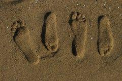 Paarabdrücke auf dem Sand Stockfoto