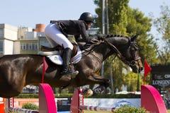 Paard die - Caitlin Ziegler springen Royalty-vrije Stock Fotografie