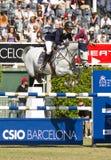 Paard die - Katharina Offel springen Stock Foto's