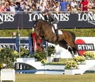 Paard die - Rutherford Latham springen Stock Afbeeldingen