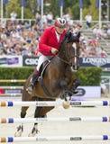 Paard die - Thomas Fruhmann springen Stock Foto's