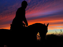 Paard en Rider Silhouette Sunset Royalty-vrije Stock Fotografie
