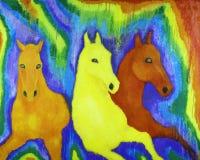 Paarden in de kleuren van de regenboog stock foto