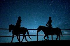 Paardrijden in het heelal stock foto