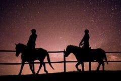 Paardrijden in het heelal stock foto's